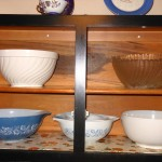 Photo of dishware in overhead cabinet